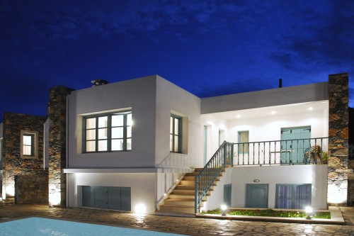 The beautiful exterior of the villa at night