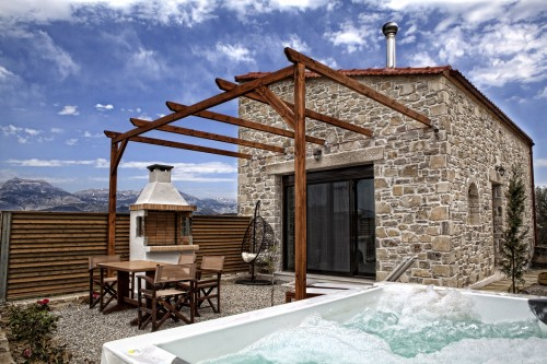 the outdoor heated jacuzzi spa and the garden of villa Omicron (please note that the patio wasn't ready in this photo)