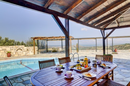 Sunny terrace with swimming pool