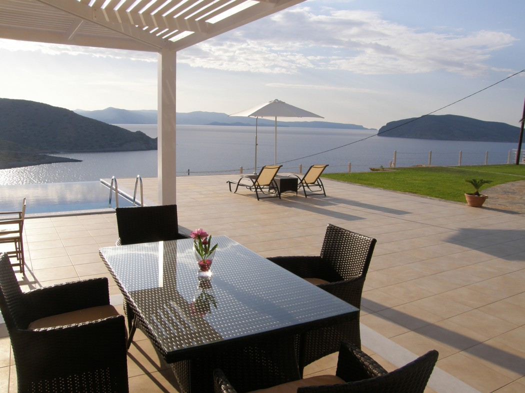 The spacious veranda has panoramic view of  the impressive bay of Mirabello.