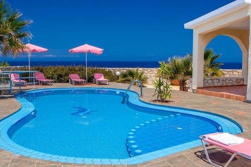 Relax by your private pool and enjoy the sunning view of the sea