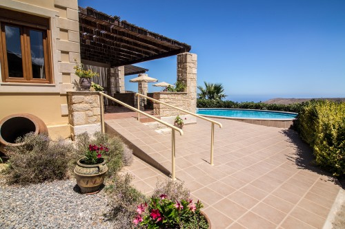 The exterior and pool area of the villa in Charkia, Rethymno