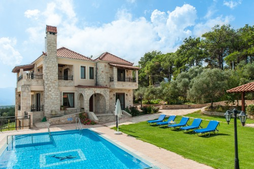 Traditional stone made mansion with pool and elevator