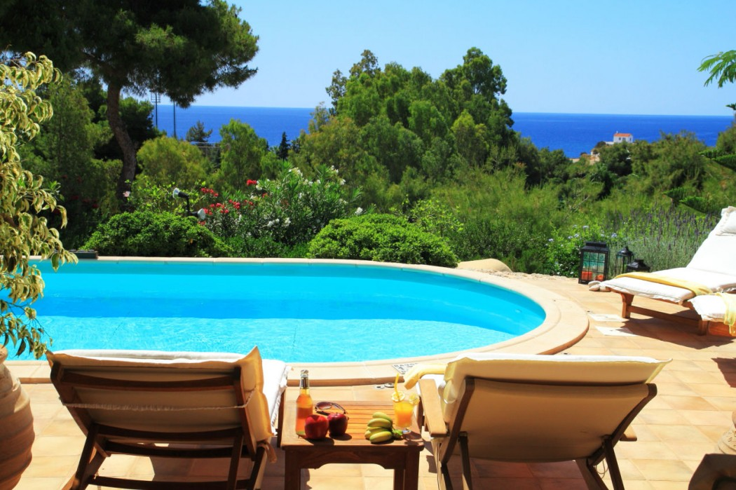 Relax by the pool and enjoy the view of the sea